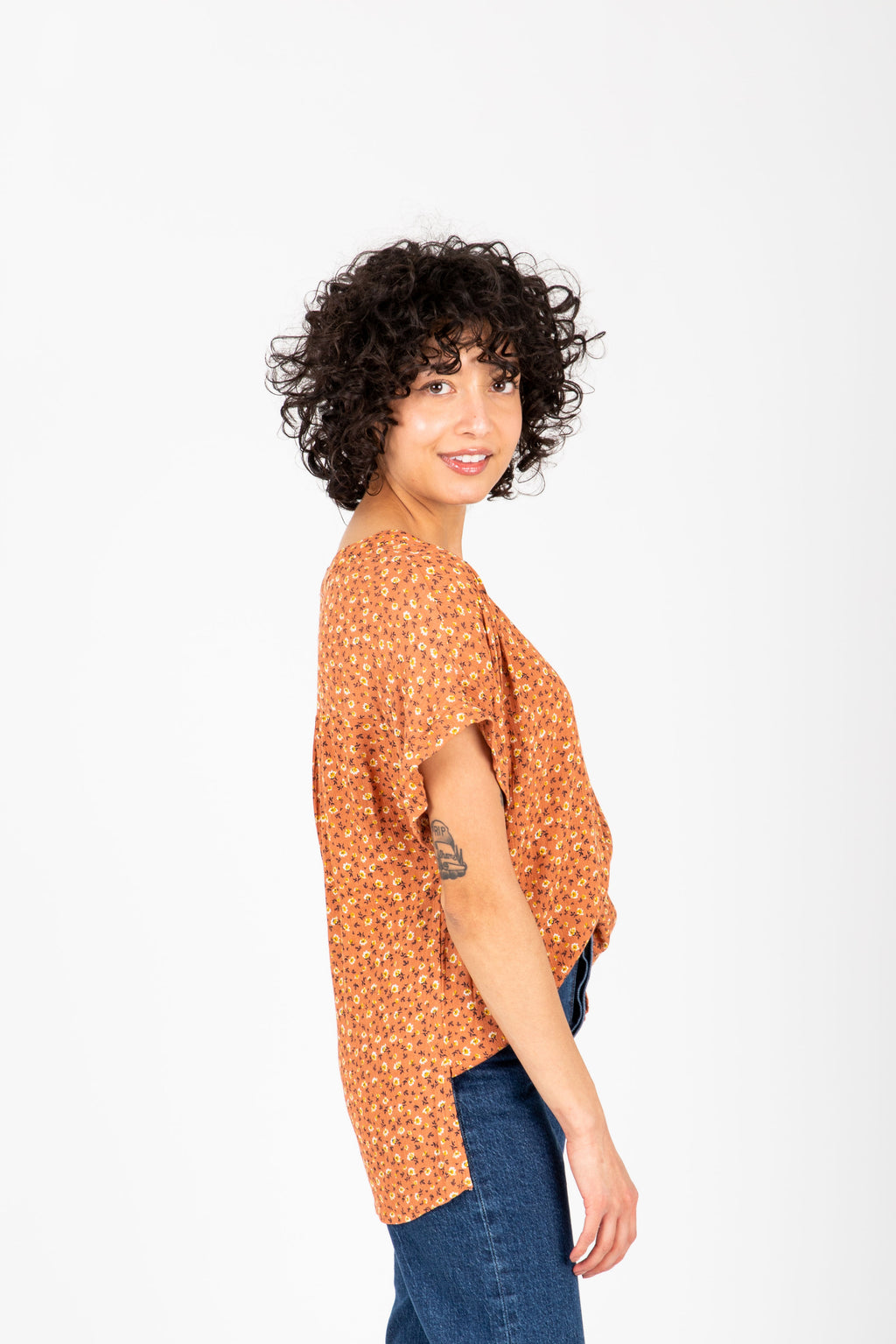 The Hayes Floral Blouse in Tangerine, studio shoot; side view