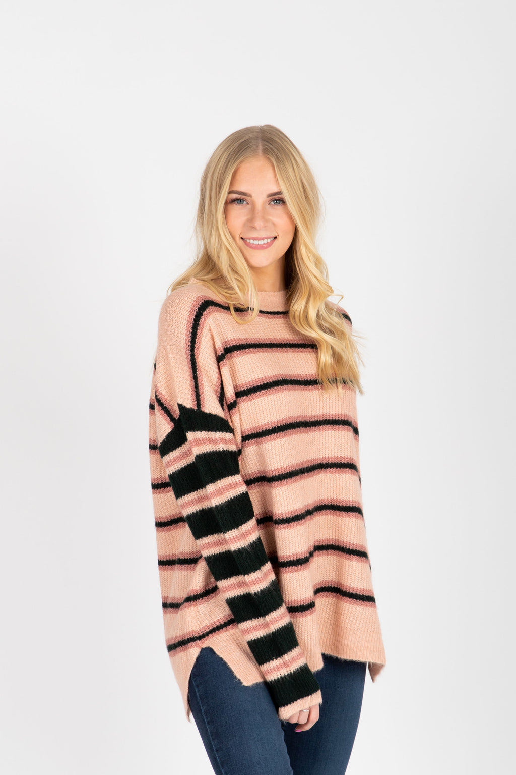 The Jayla Striped Sweater in Blush, studio shoot; front view