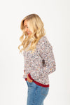 The Peak Speckled Trim Sweater in Grey, studio shoot; side view