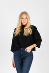 The Nicholls Ruffle Trim Mock Neck in Black