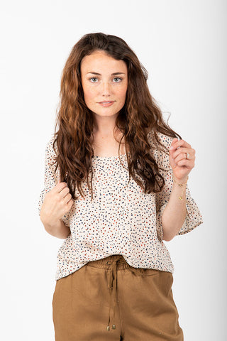 de5e8d27fe319b The Pollock Patterned Ruffle Sleeve Blouse in Ivory.   32.00. The Swan  Patterned Peplum Blouse in White
