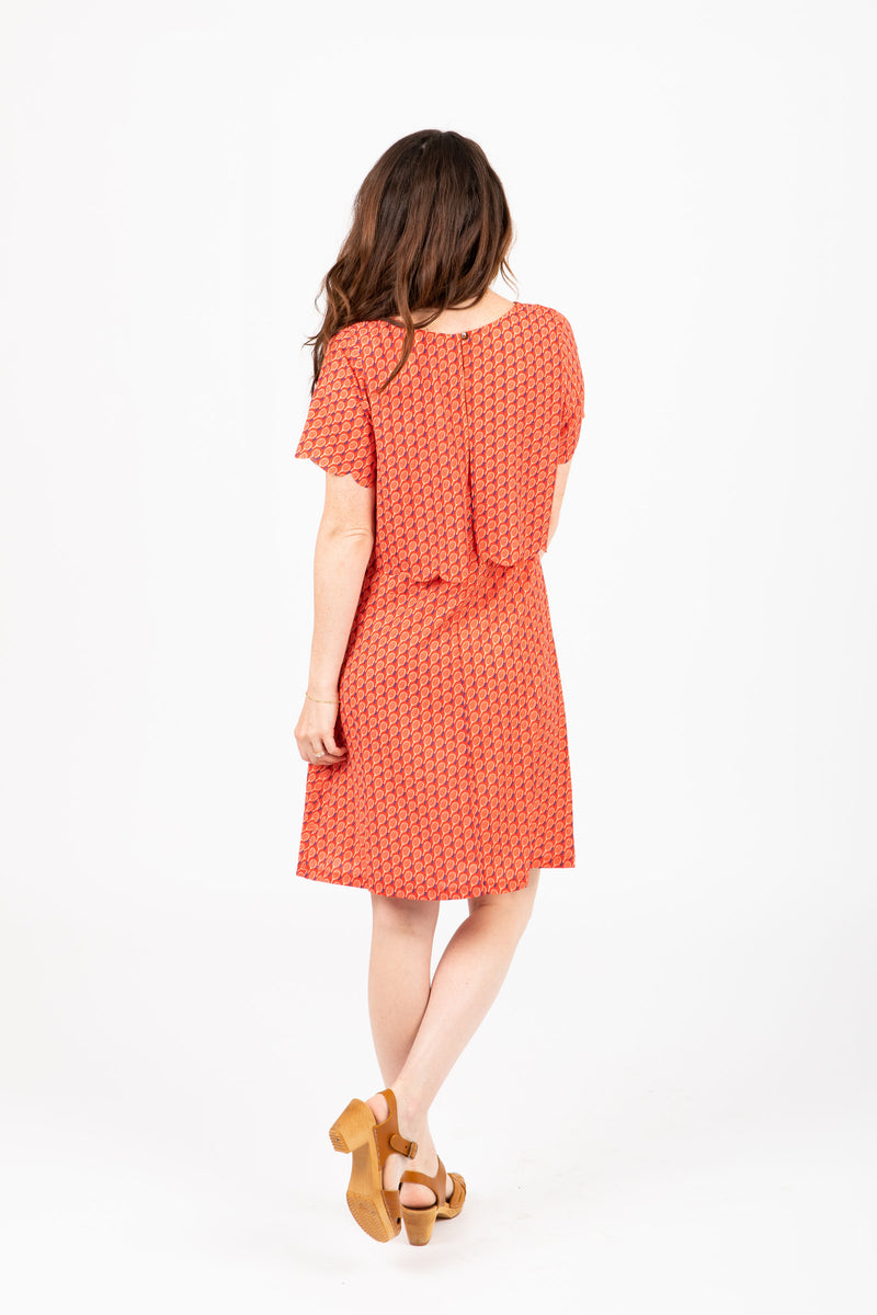 The Tennis Scalloped Bib Dress in Poppy
