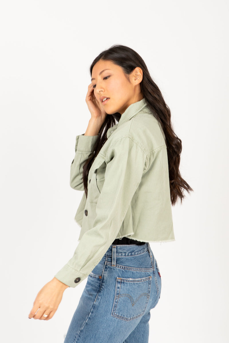 The Gia Utility Shirt Jacket in Olive, studio shoot; side view