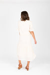 The Skipper Swiss Dot Blouse in Ivory, studio shoot; back view