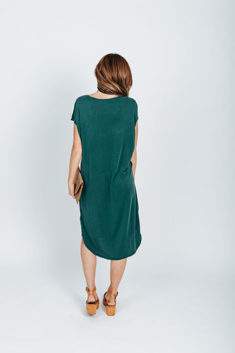 The Bahama Round Neck Casual Dress in Emerald Green, studio shoot; back view