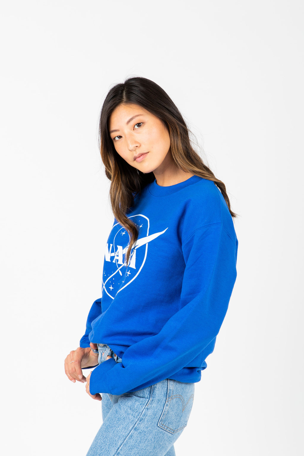 The Nasa Galaxy Crewneck in Royal Blue, studio shoot; side view