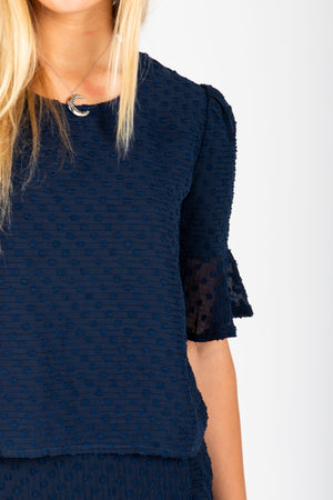 The Skipper Swiss Dot Blouse in Navy, studio shoot; front view