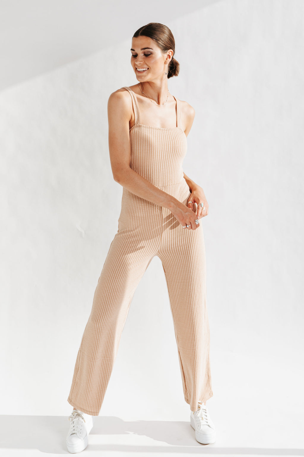 The Lagos Ribbed Wide Leg Jumpsuit in Taupe, studio shoot; front view
