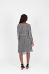 The Florence Patterned Pleat Dress in Black, studio shoot; back view
