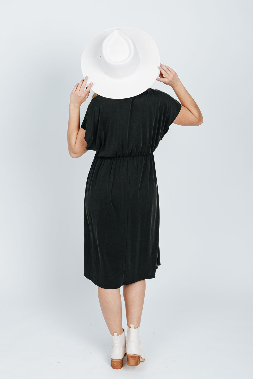 The Aruba V-Neck Casual Dress in Black, studio shoot; back view