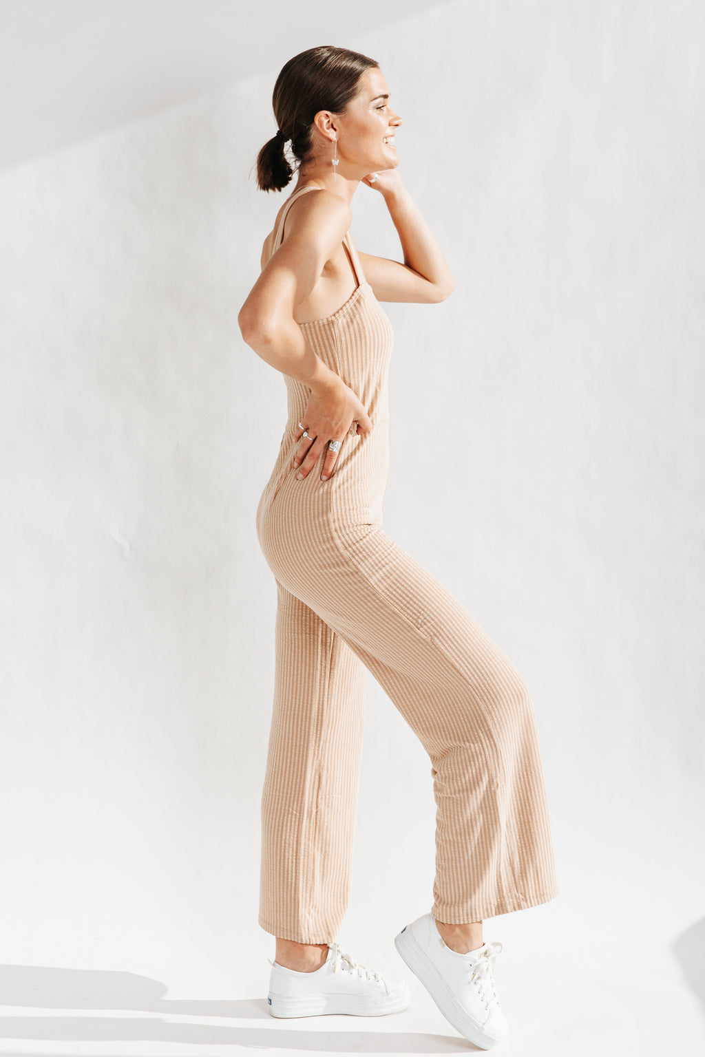 The Lagos Ribbed Wide Leg Jumpsuit in Taupe, studio shoot; side view