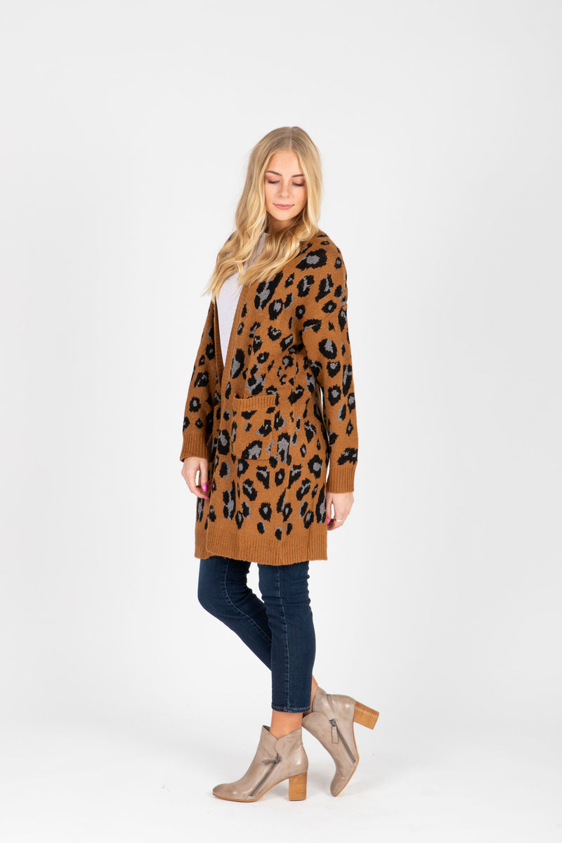 The Sebastian Leopard Cardigan Sweater in Camel, studio shoot; side view