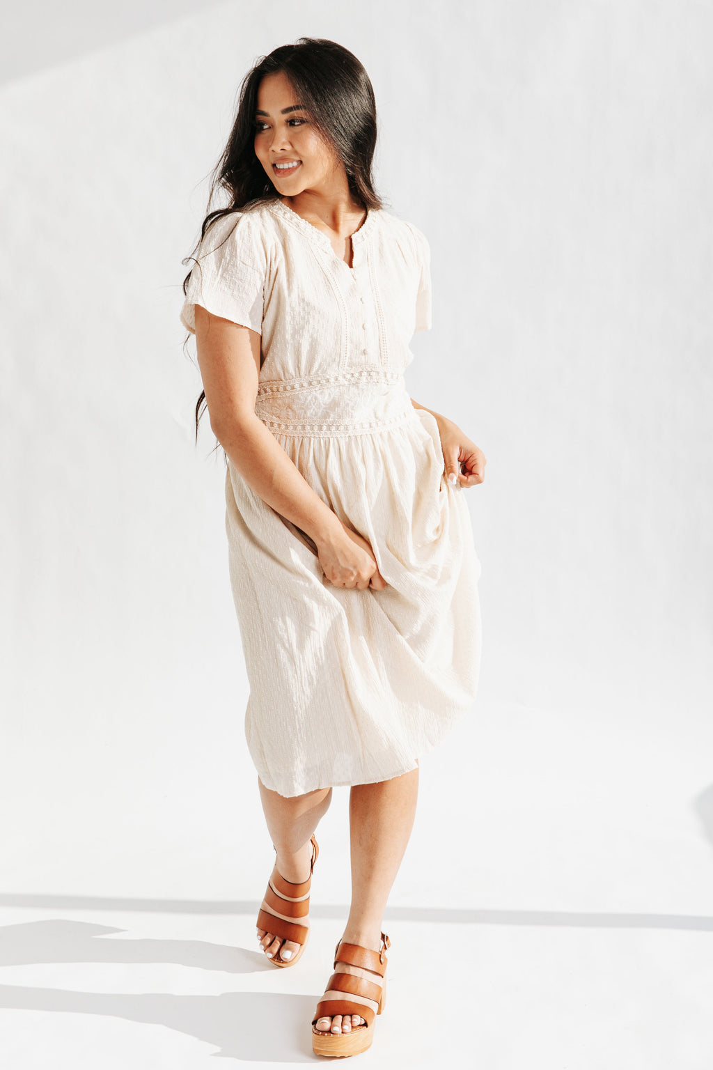 The Bynes Embroidered Midi Dress in Natural, studio shoot; front view