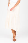 The Skipper Swiss Dot Skirt in Ivory, studio shoot; front view