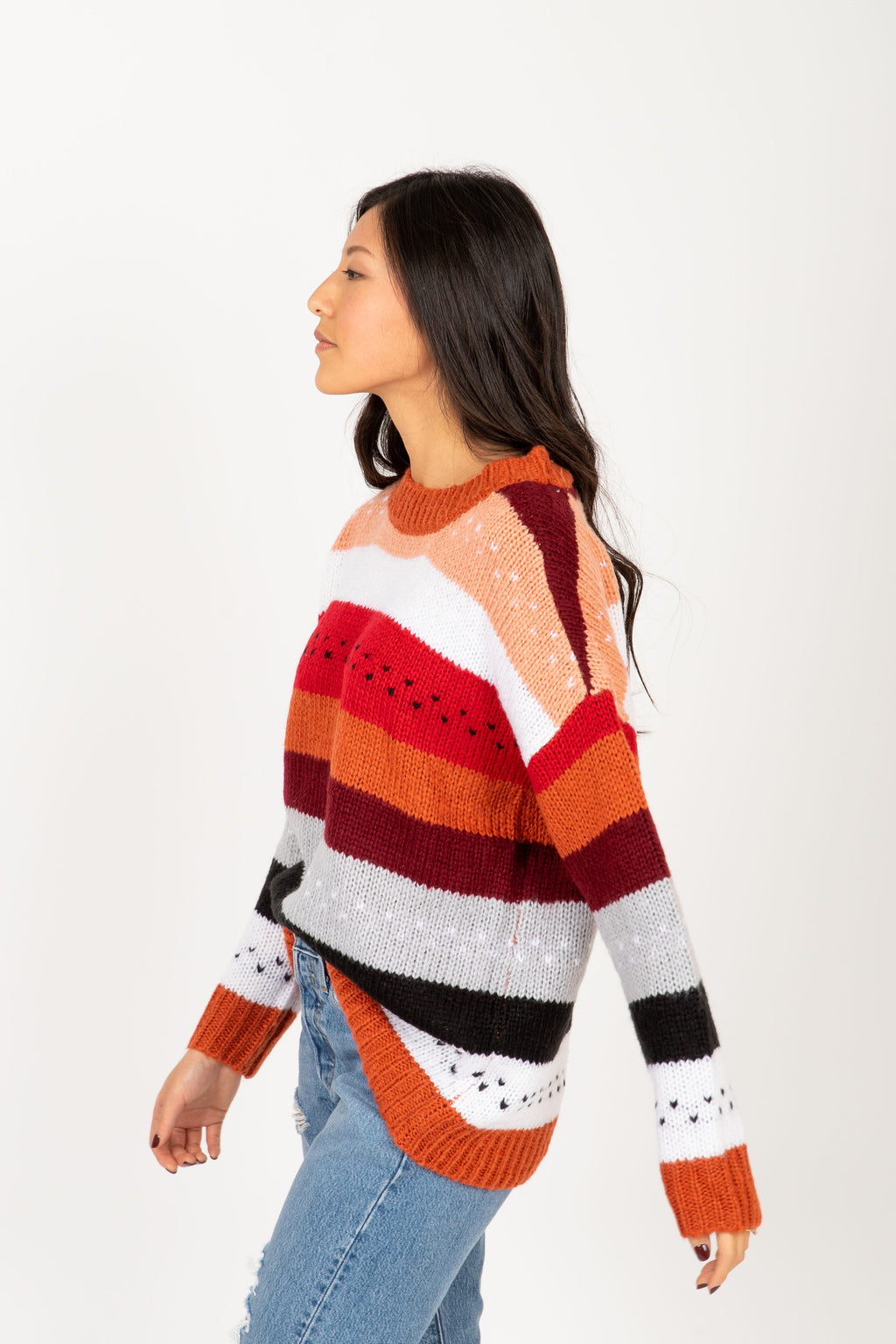 The Chelsea Striped Sweater in Rose Multi, studio shoot; side view
