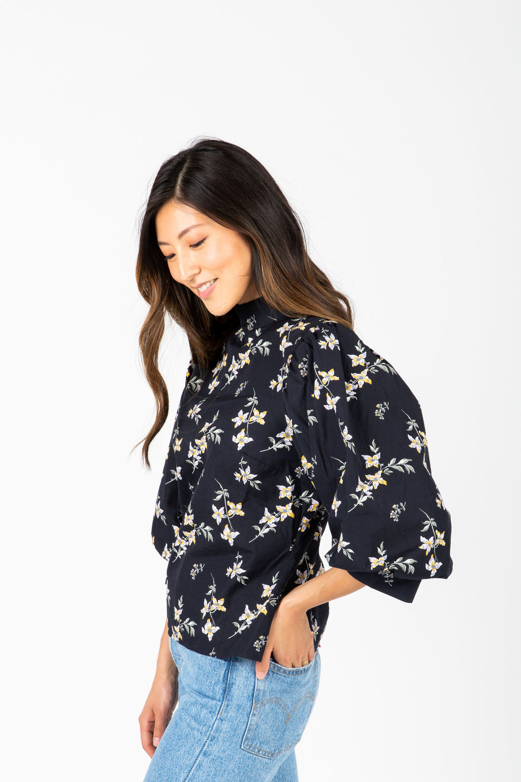 Levi's: High Neck Floral Balloon Sleeve Blouse in Navy, studio shoot; side view