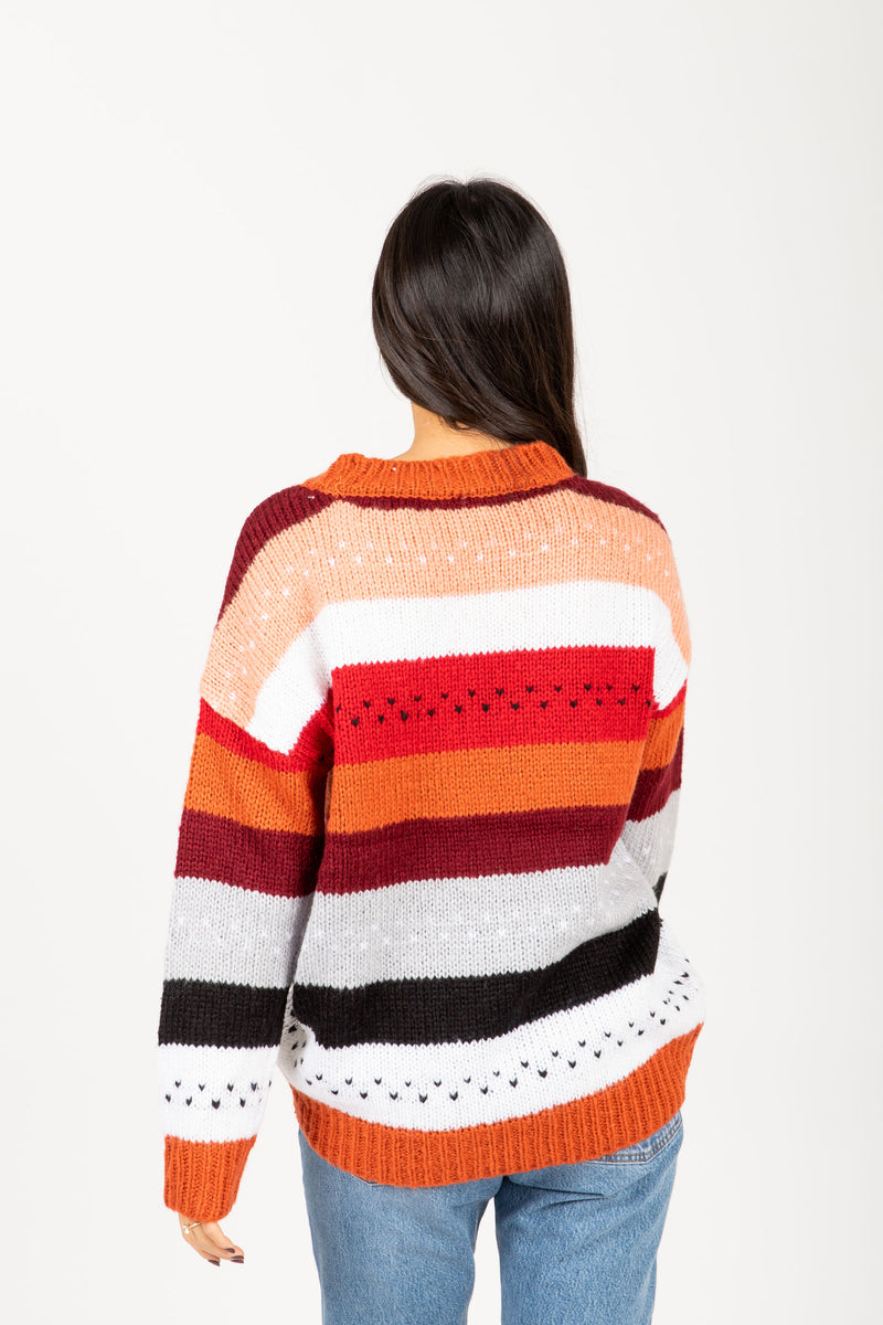 The Chelsea Striped Sweater in Rose Multi, studio shoot; back view