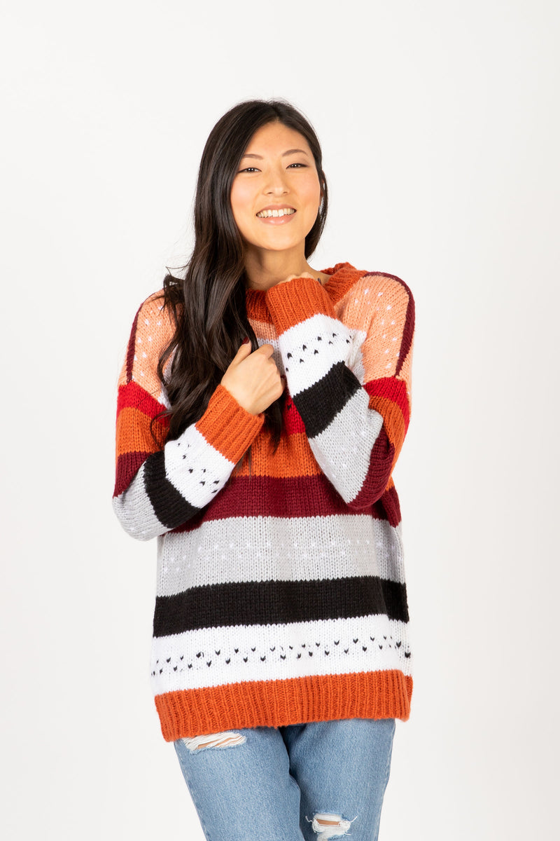 The Chelsea Striped Sweater in Rose Multi, studio shoot; front view