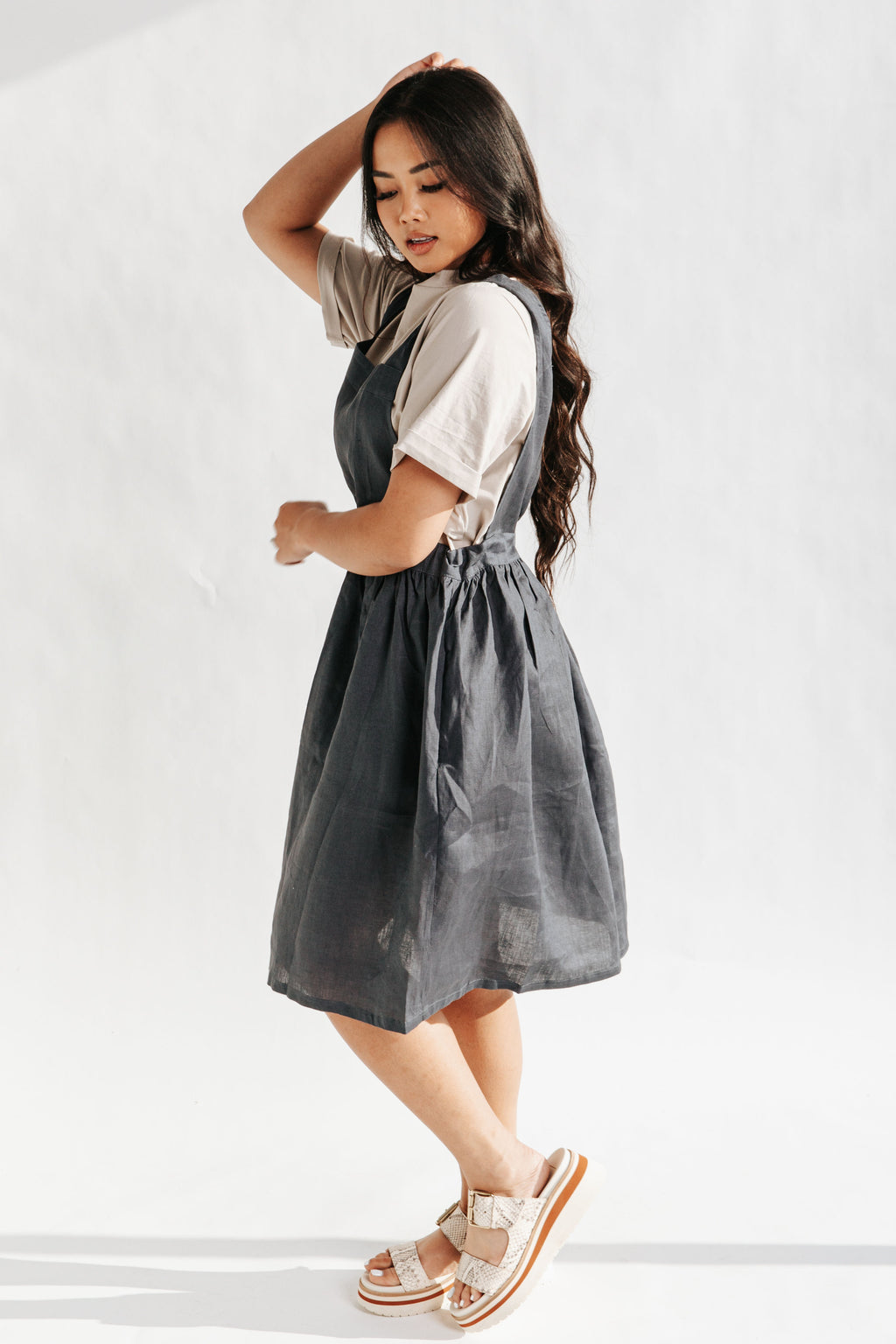 The Baltimore Linen Jumper Dress in Navy, studio shoot; side view