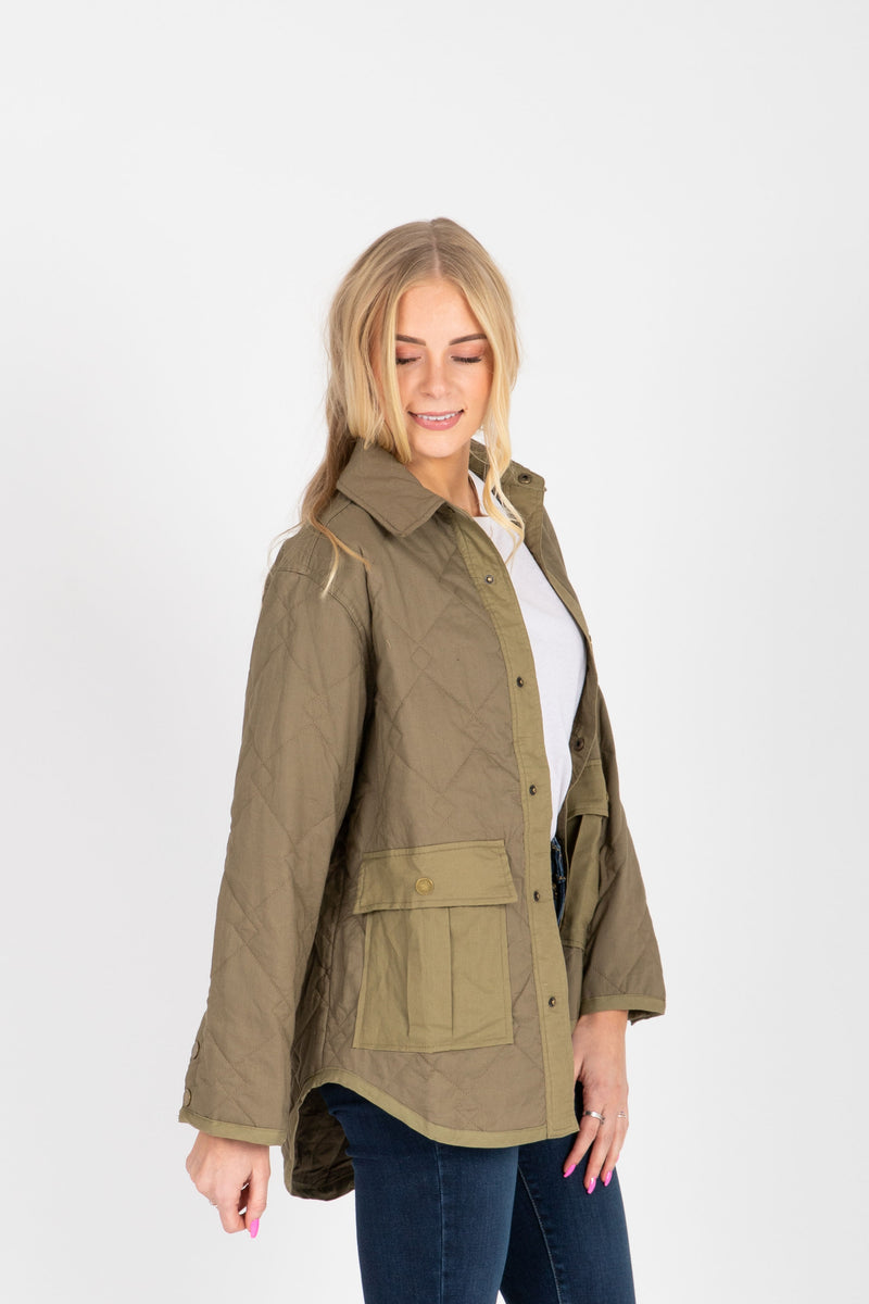 The Tanya Quilted Jacket in Olive, studio shoot; side view