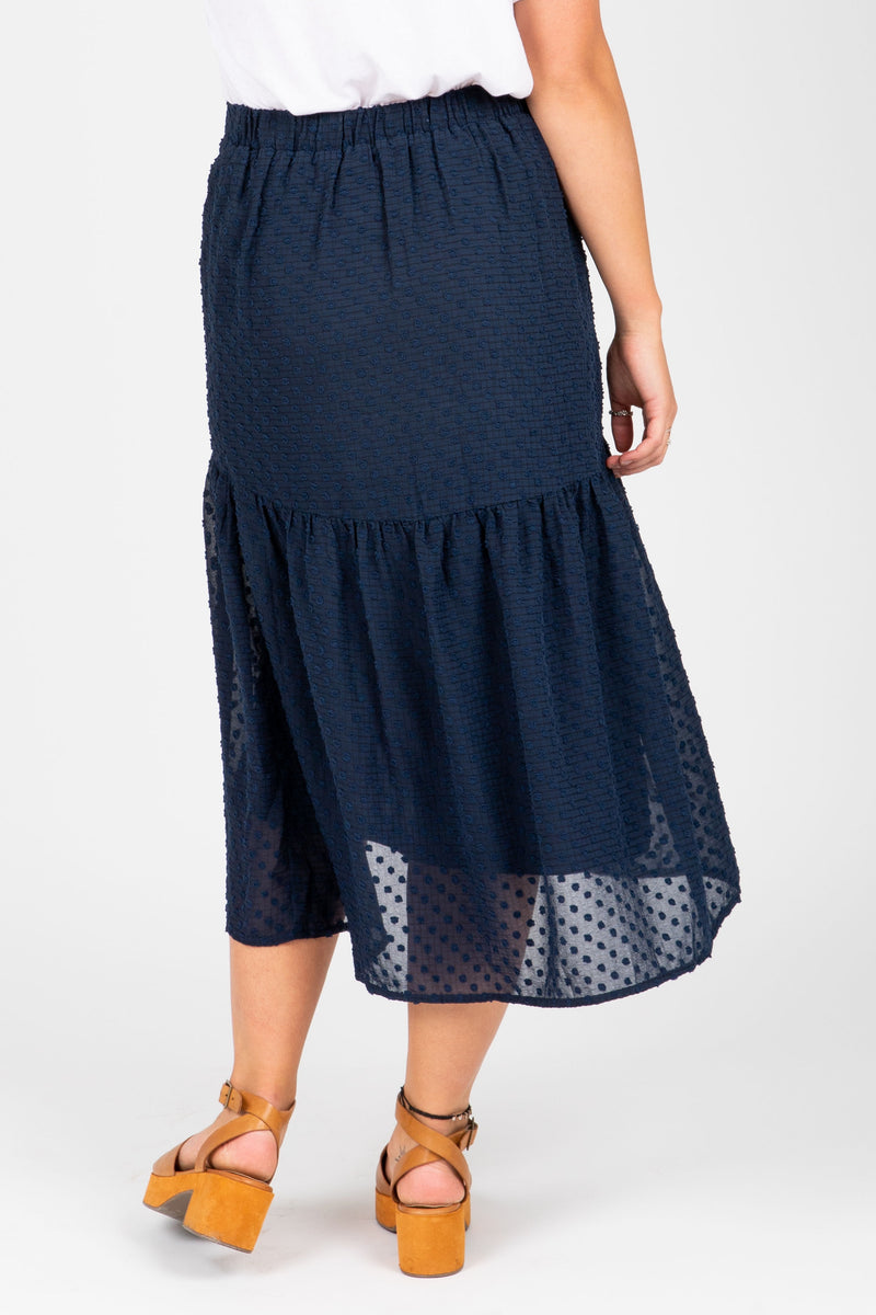 The Skipper Swiss Dot Skirt in Navy, studio shoot; back view