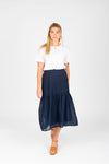 The Skipper Swiss Dot Skirt in Navy, studio shoot; front view