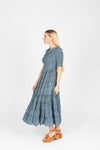 The Mumulo Pattern Smocked Tiered Dress in Blue, studio shoot; side view