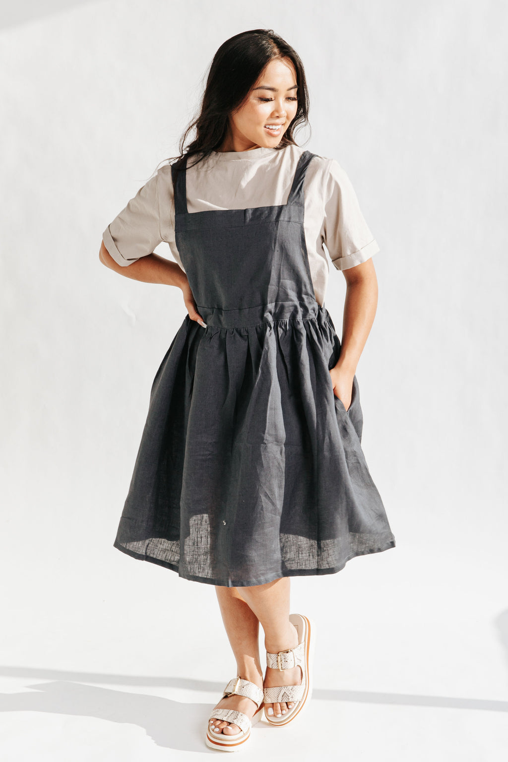 The Baltimore Linen Jumper Dress in Navy, studio shoot; front view