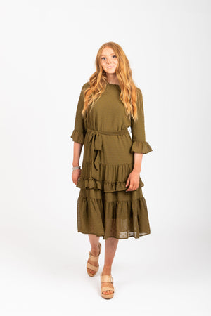 The Hallie Swiss Dot Ruffle Dress in Moss, studio shoot; front view