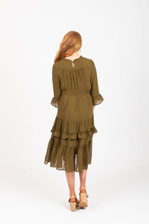 The Hallie Swiss Dot Ruffle Dress in Moss, studio shoot; back view