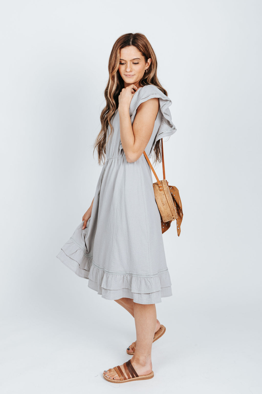 The Davies Ruffle Detail Dress in Light Grey, studio shoot; side view