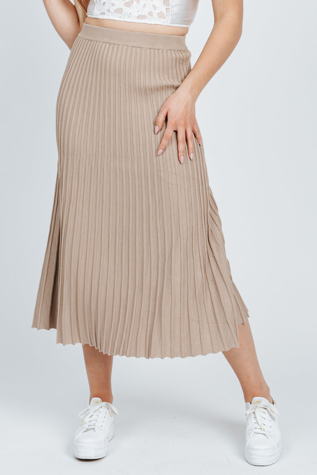 The Havilliard Pleated Skirt in Taupe, studio shoot; front view