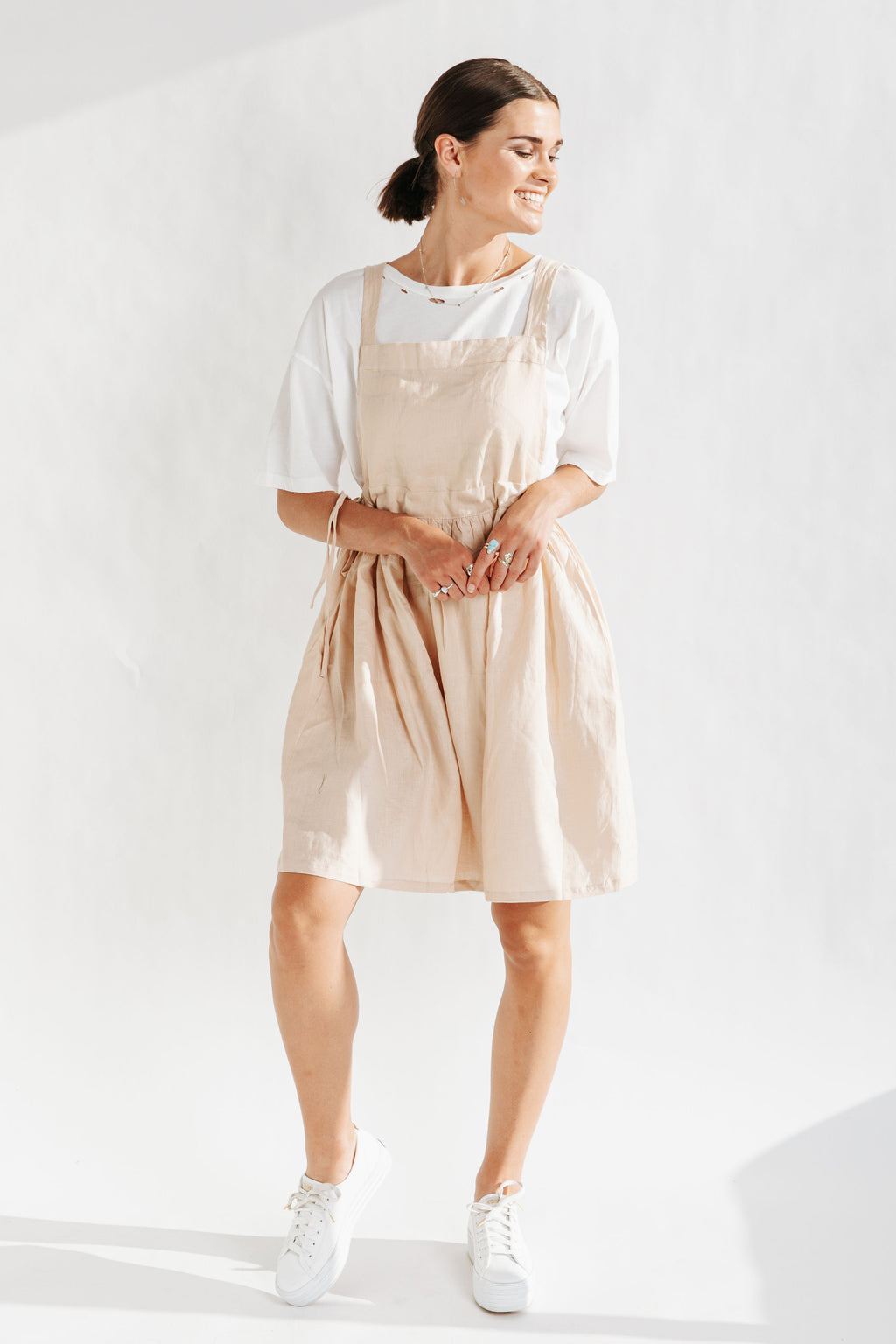The Baltimore Linen Jumper Dress in Taupe, studio shoot; front view