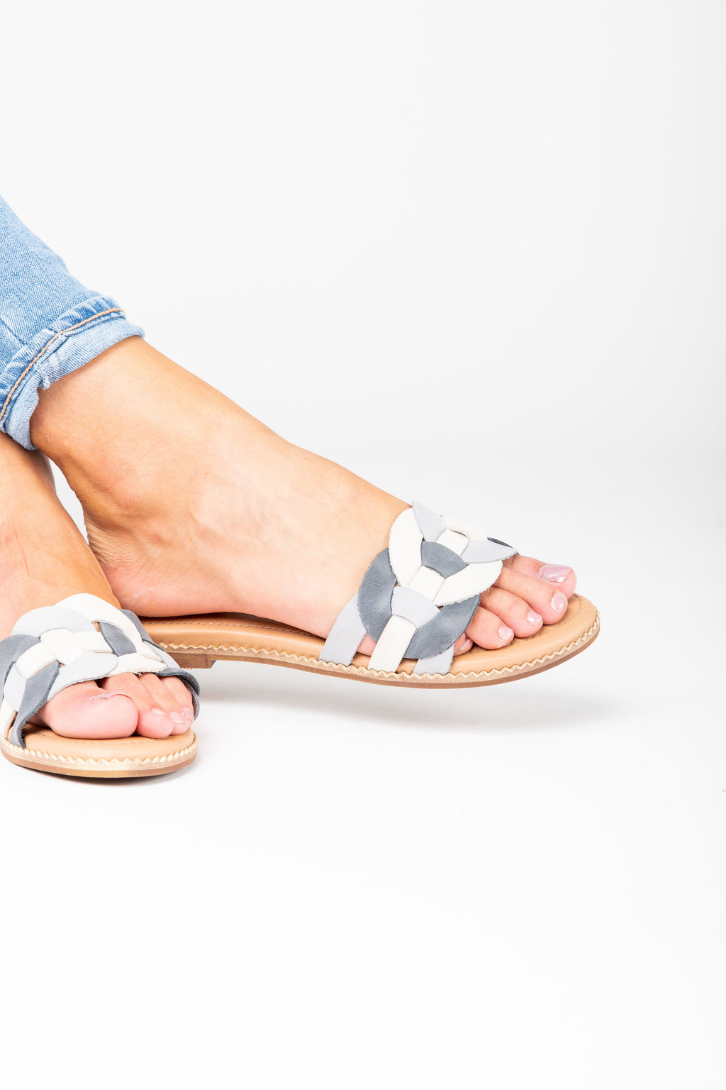 Crevo Footwear: The Poppi Slide Sandal in Dusty Blue, studio shoot; side view