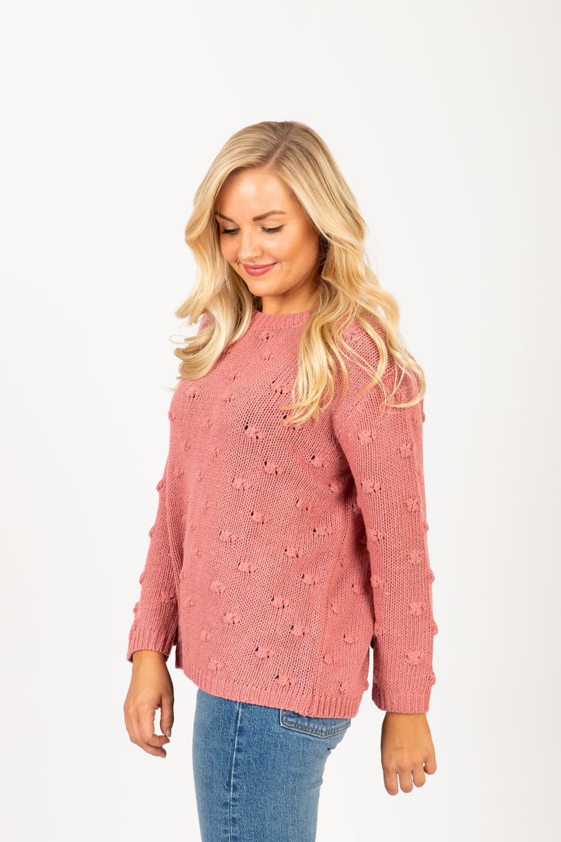 The Mist Pom Sweater in Mauve, studio shoot; side view