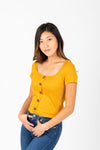 The Colfer Ribbed Button Blouse in Mustard, studio shoot; front view