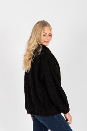 The Barry Sherpa Zip Up Jacket in Black, studio shoot; side view