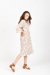The Silvan Floral Pleated Dress in Ivory, studio shoot; side view
