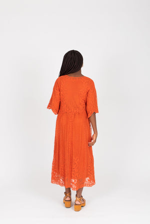 The Jason Lace Dress in Poppy, studio shoot; back view