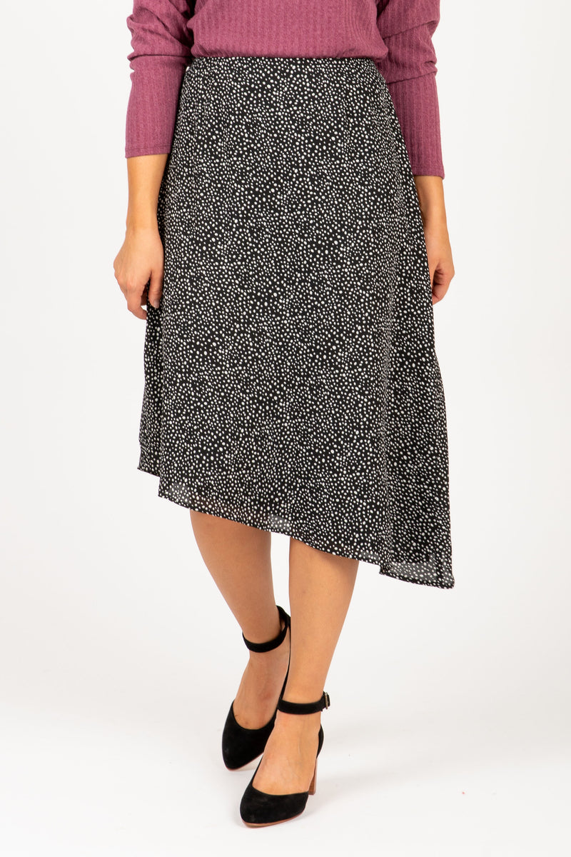 The Arctic Dot Asymmetrical Skirt in Black, studio shoot; front view