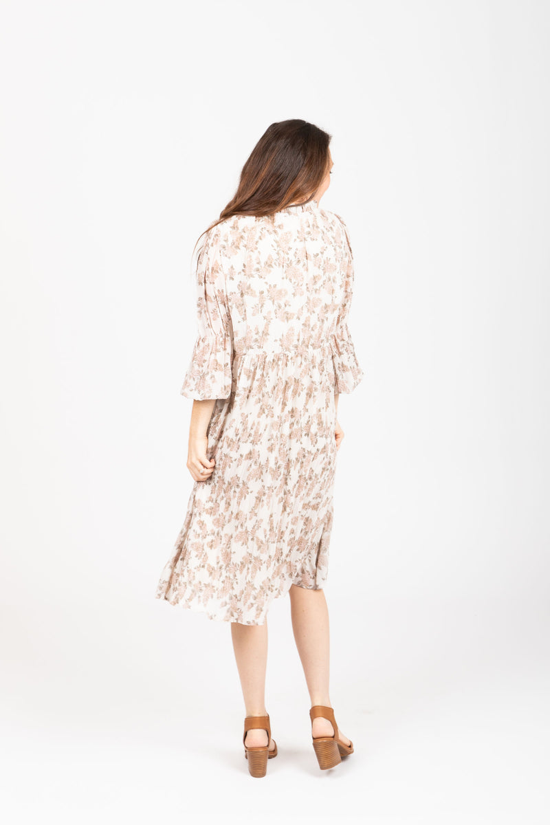 The Silvan Floral Pleated Dress in Ivory, studio shoot; back view