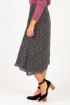 The Arctic Dot Asymmetrical Skirt in Black, studio shoot; side view