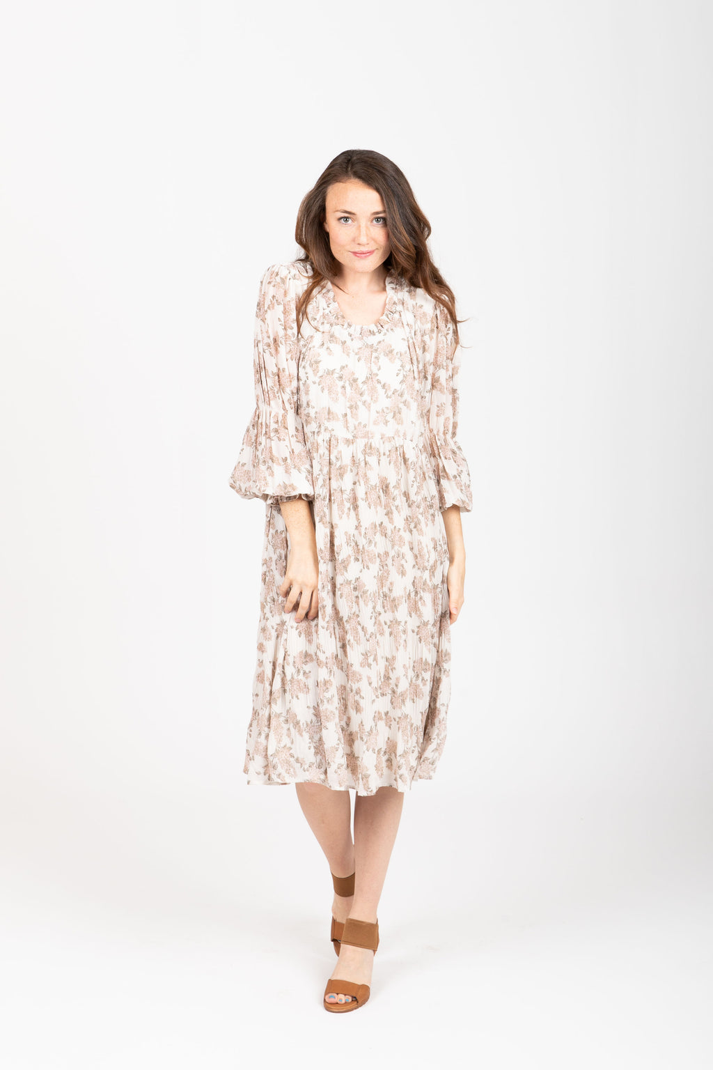 The Silvan Floral Pleated Dress in Ivory, studio shoot; front view