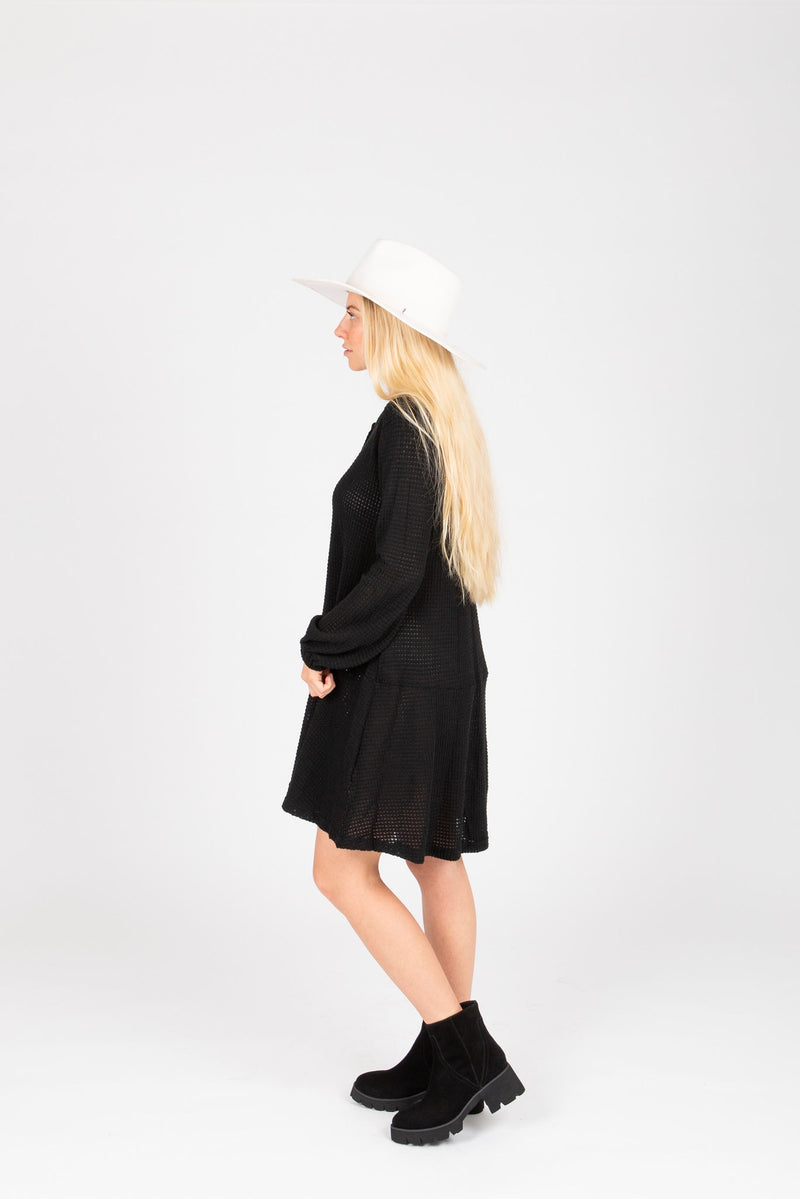 The Gobi Waffle Casual Dress in Black, studio shoot; side view
