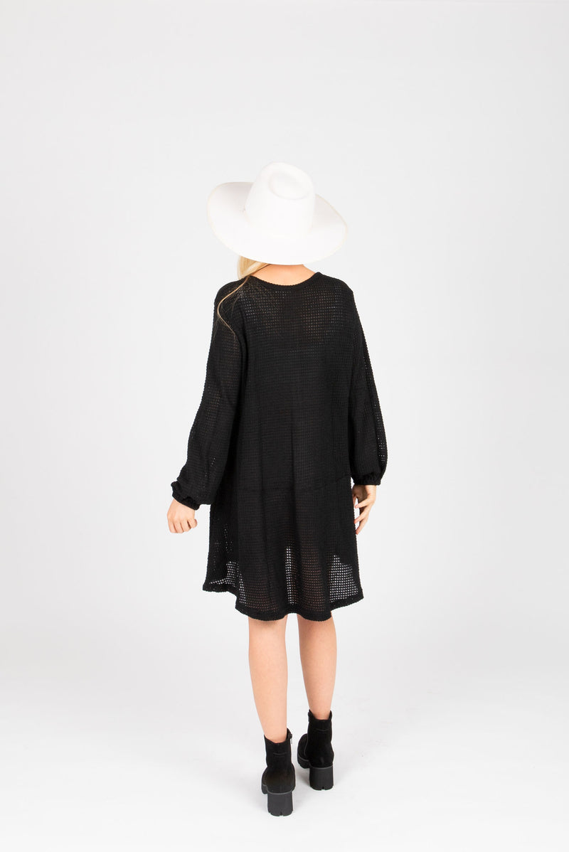 The Gobi Waffle Casual Dress in Black, studio shoot; back view