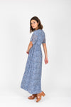 The Liana Floral Smocked Dress in Blue, studio shoot; side view