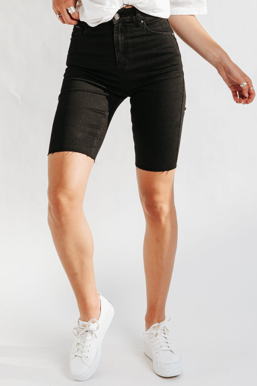The Ashburn High Rise Denim Biker Short in Black, studio shoot; front view