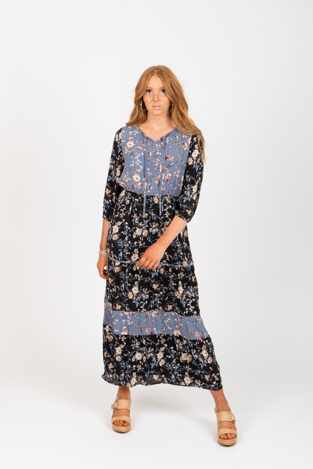 The Haskell Floral Contrast Maxi Dress in Black, studio shoot; front view
