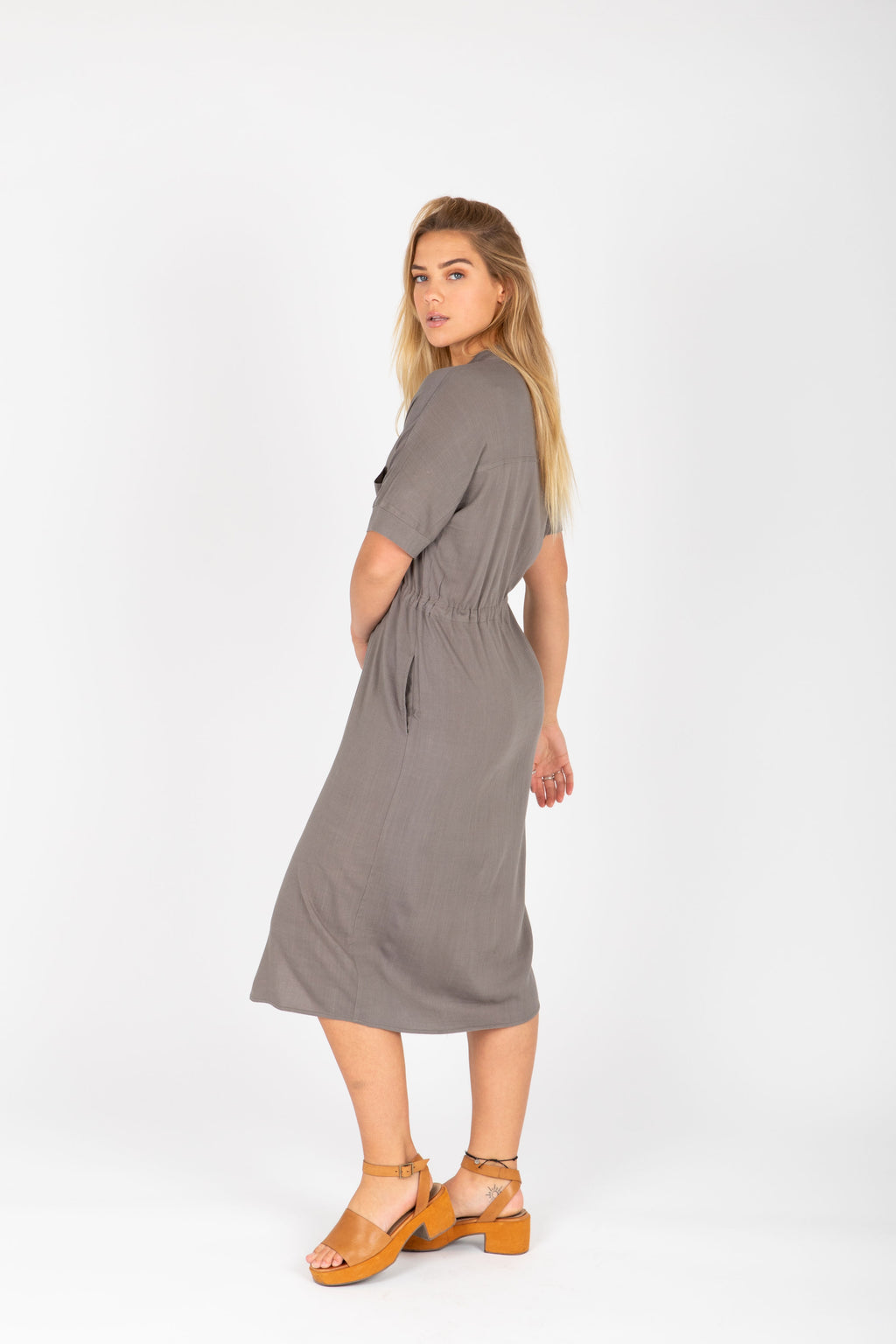 The Lacey Button Casual Dress in Stone, studio shoot; side view