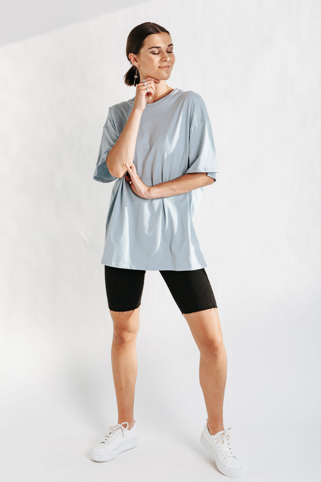 The Grover Oversized Tee in Light Blue, studio shoot; front view